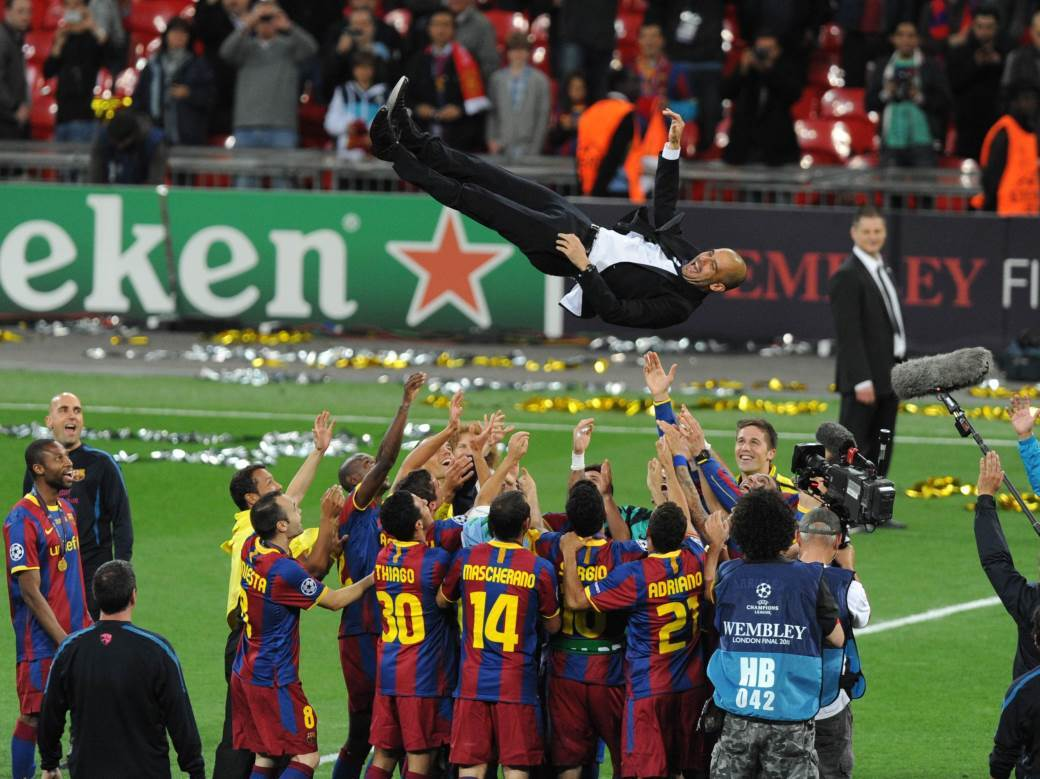 MANCHESTER;UNITED;V;BARCELONA;CHAMPIONS;LEAGUE;FINAL;WEMBLEY;STADIUM;LONDON;BRITAIN;28;MAY;2011;MANAGER;PEP;GUARDIOLA;IS;THROWN;IN;THE;AIR;BY;HIS;PLAYERS;AFTER;WINNING;10088460